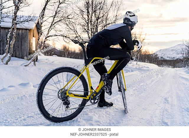 Man cycling at winter