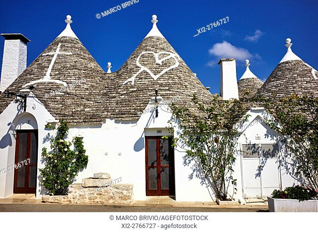 Alberobello, Apulia, Italy. A trullo (plural, trulli) is a traditional Apulian dry stone hut with a conical roof. Their style of construction is specific to the...