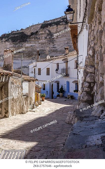 Narrow street with white painted houses, typical of this town, take in Alcala of the Jucar, Albacete province, Spain