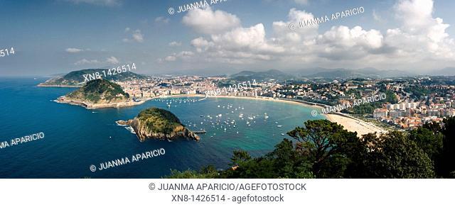 Panoramic view of the Bahia de La Concha, Mount Urgull and Santa Clara Island from Mount Igueldo Donostia-San Sebastian, Basque Country, Spain