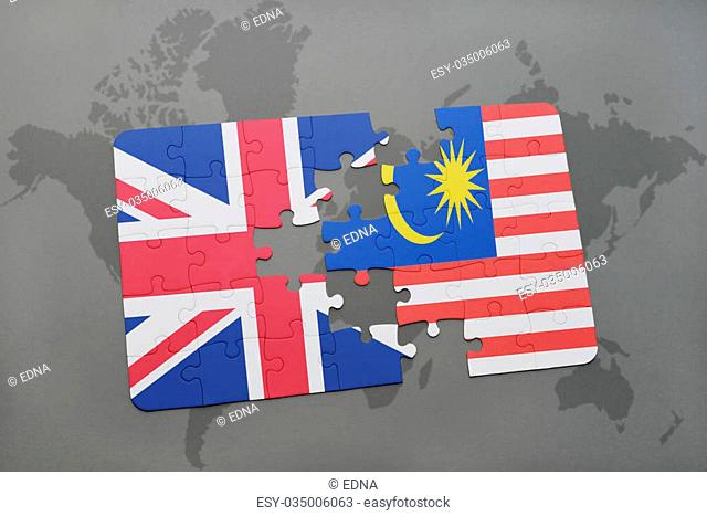 puzzle with the national flag of great britain and malaysia on a world map background