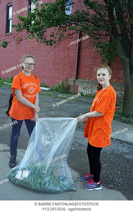 Middle School Girls Collecting Debris for Community Service Day, Wellsville, New York, USA