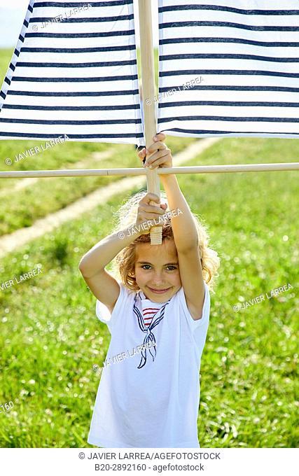 Girl playing with kite, Zarautz, Gipuzkoa, Basque Country, Spain, Europe