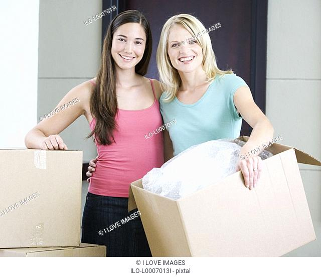 A mother and daughter moving into a new home