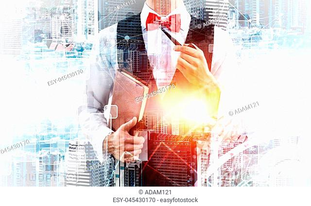 Confident and young businessman in smart-casual wear smoking pipe and modern cityscape with business and media interface