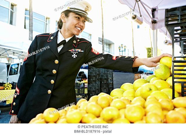 Asian soldier shopping in farmers market