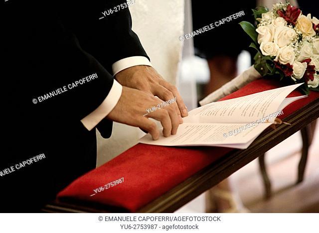 Groom hands, in church