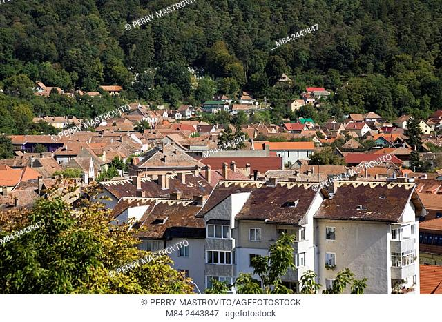 Residential apartment and condominium building rooftops in town of Sighisoara in autumn, Romania, Eastern Europe