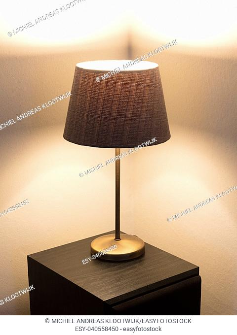 Table lamp standing on a large speaker - Light is on