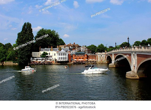 England Surrey Hampton Court Hampton Court Bridge over the River Thames with pleasure boat activity Peter Baker