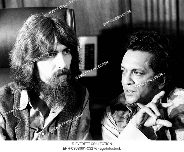 Former Beatle George Harrison (left) and Indian musician Ravi Shankar talk to newsmen in New York. July 27, 1971. Their planned concert to benefit East...