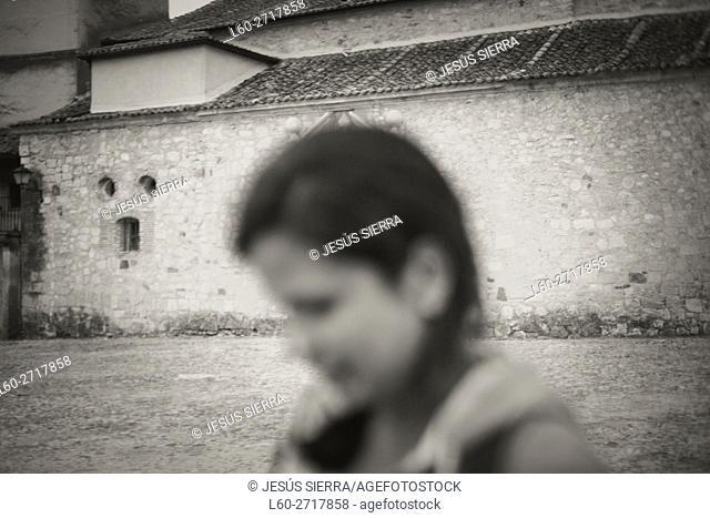 Girl in main Square, Pedraza. Segovia province, Castilla-Leon, Spain