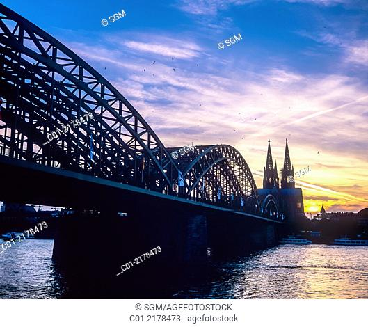 Hohenzollern bridge and cathedral at sunset Cologne Germany