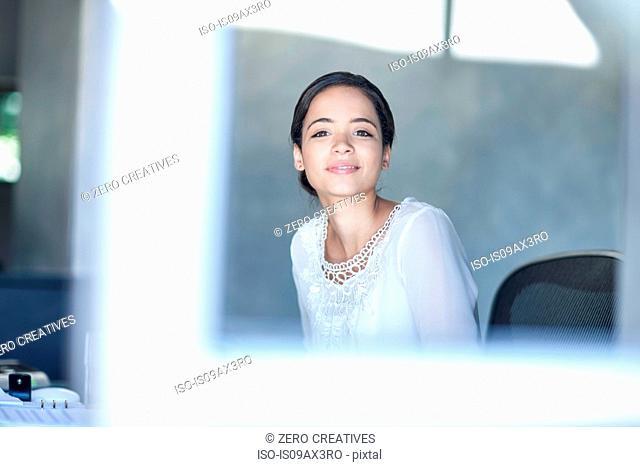 Portrait of businesswoman working at office desk