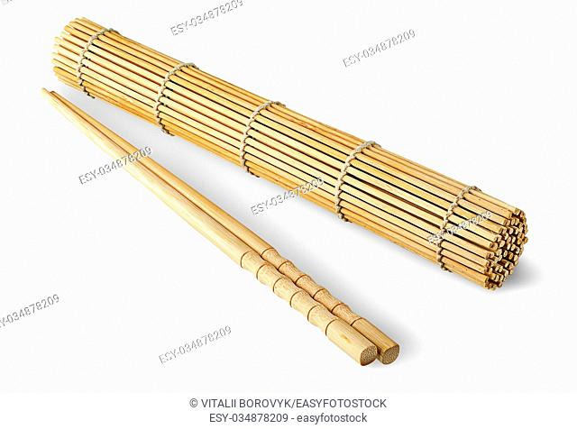 Sushi mat roll up and chopsticks isolated on a white background
