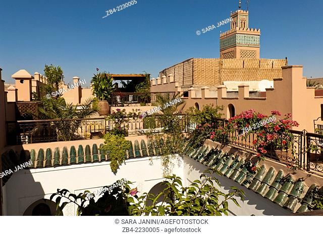 View of a mosque and roof of a Moroccan riad inside the Medina, Marrakesh or Marrakech, Morocco, North Africa