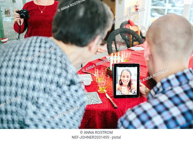 Family talking via digital tablet