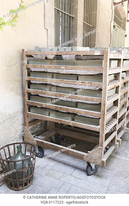 Mellow green blocks of olive Marseille soap on traditional wooden racks drying in the sun outside the Marius Fabre soap factory, Salon, Provence, France