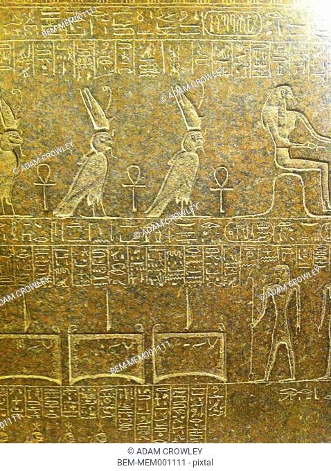 Close up of hieroglyphs carved on wall