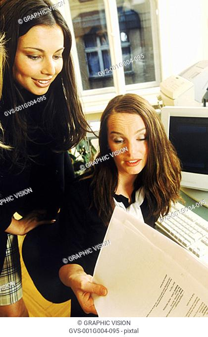 Two young businesswomen working together