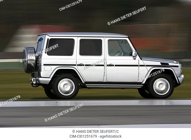 Mercedes G 320 CDI, model year 2007-, silver, driving, side view, country road