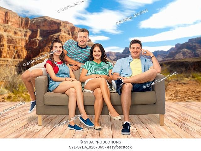 friends sitting on sofa over grand canyon