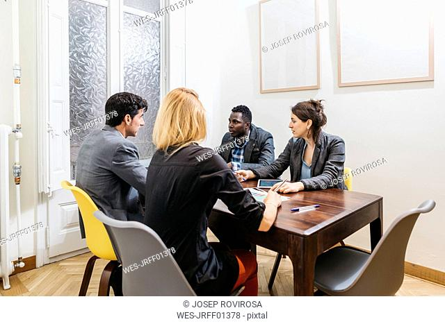 Young business people having a meeting in board room