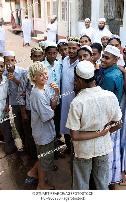 Muslim boys talk to a tourist in Galle Fort, Sri Lanka