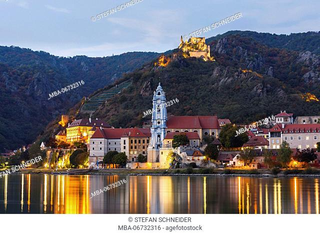 Blue hour in the Wachau with church, historical heart of village and castle ruin in the background