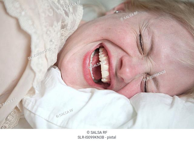 Face of young woman laughing
