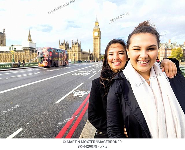 Two girls in front of Big Ben, City of Westminster, London, England