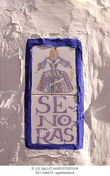 Women's room sign