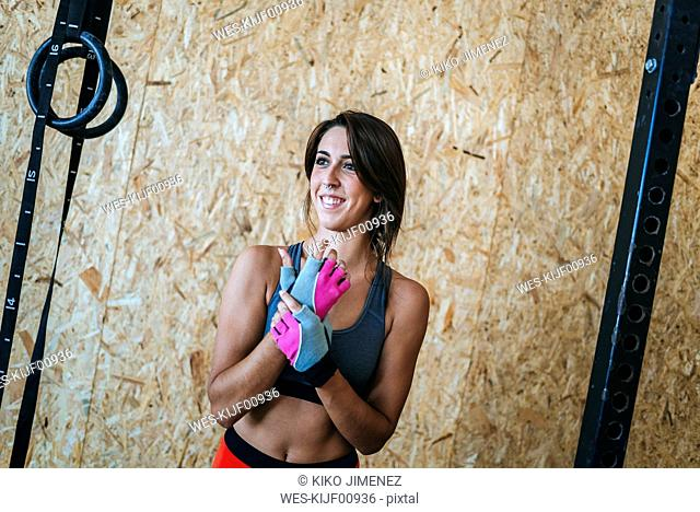 Smiling woman in gym