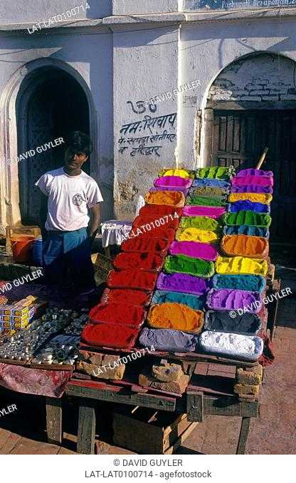 Pashupatinath. Stall in road. Brightly coloured tika dyd powders on display
