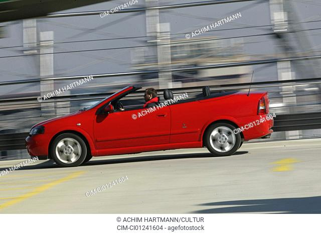 Car, Opel Astra Convertible, diesel engine, model year 2000-, orange , open top, driving, side view