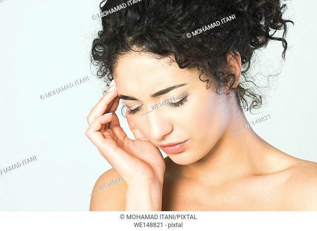 Close up of a young woman hand on head in pain