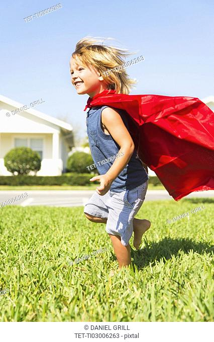 Boy (4-5) running with cape