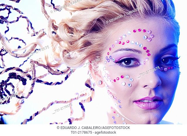 blond girl with fancy hairstyle and makeup