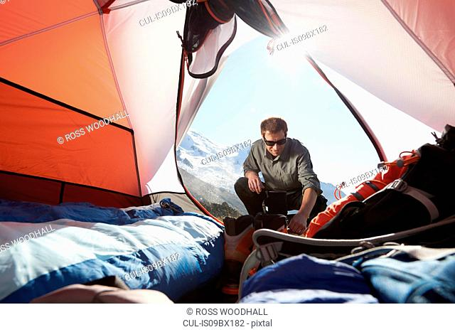 Mountain climber camping, Chamonix, Rhone-Alps, France