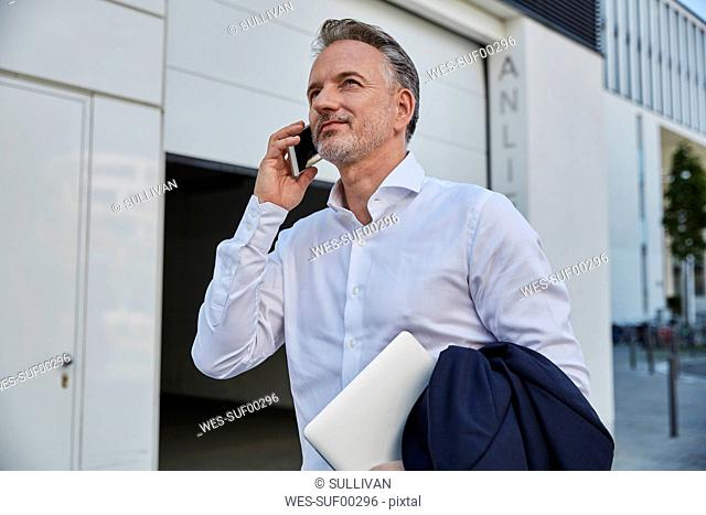 Portrait of businessman on the phone