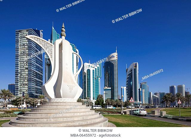 Qatar, Doha, Doha Bay, West Bay Skyscrapers, morning, with large coffeepot sculpture