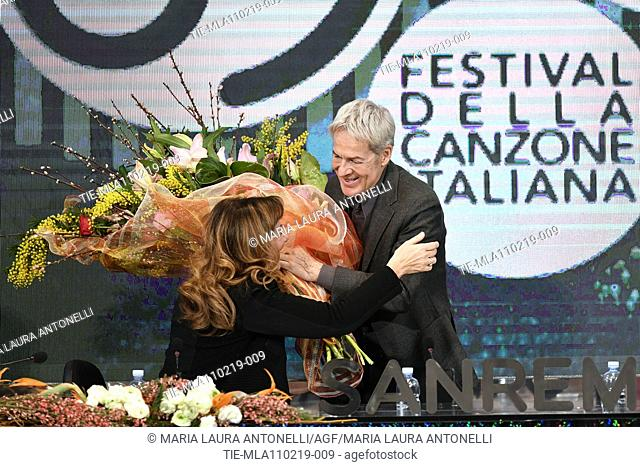Claudio Baglioni gives to Director of Rai 1 Teresa De Santis a bouquet of flowers during the final press conference of 69th Sanremo Music Festival, Sanremo