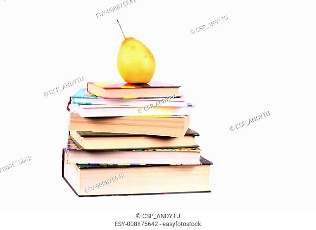 pyramid of books yellow pear on the top