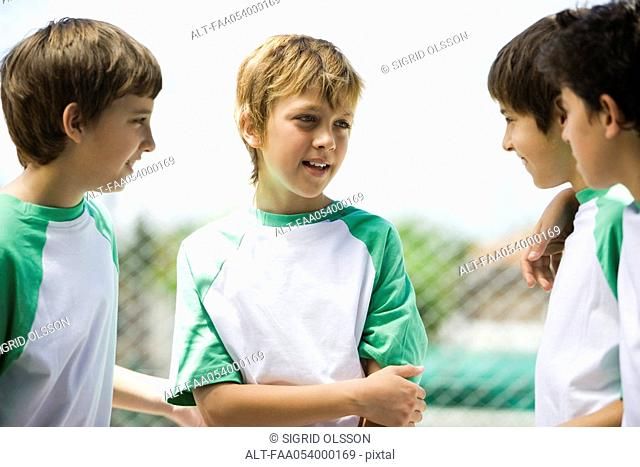 Boys chatting outdoors