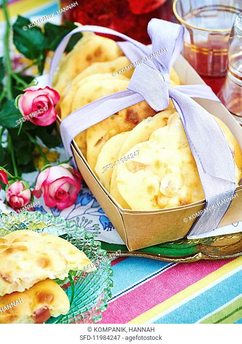 Apple and rhubarb cakes in a box with a bow