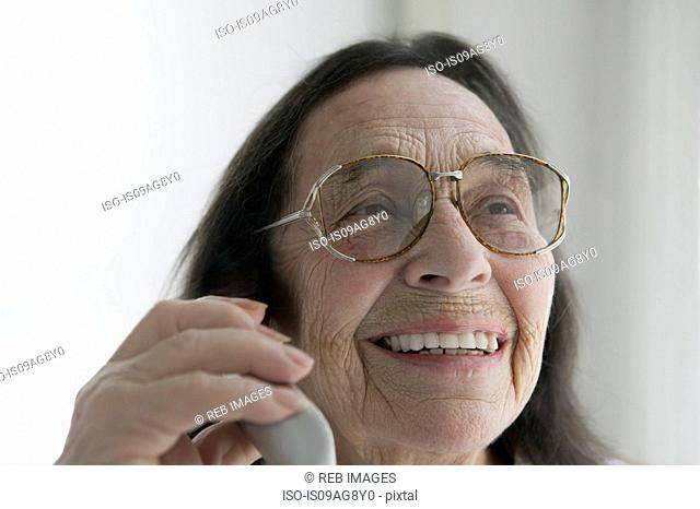 Senior woman wearing glasses on the phone