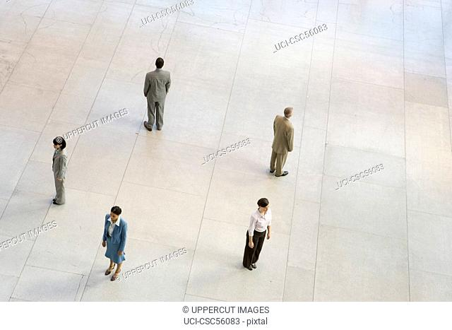 Businesspeople standing in circle