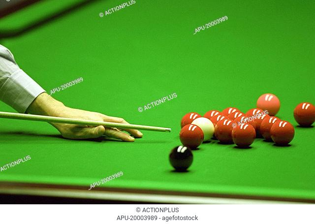 Close up view of a man playing snooker