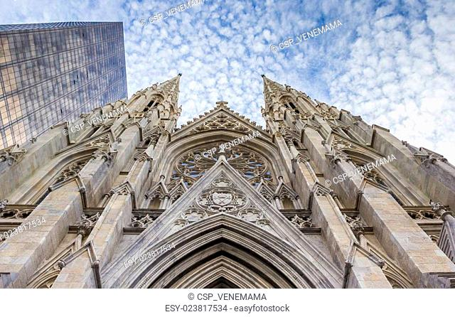 Front of St. Patricks Cathedral and a skyscraper in New York
