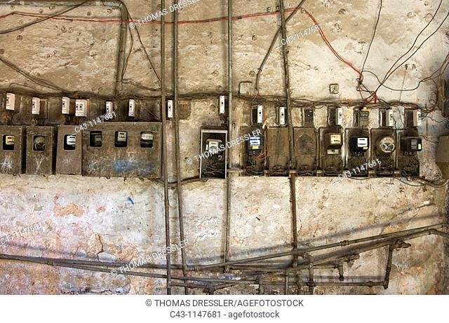 Cuba - Antiquated electric meters and pipes in the ground floor of a building in Habana Vieja, the Old Town of Cuba's capital Havana